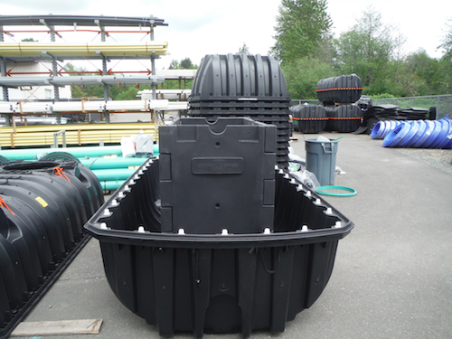 The Washington system features a wastewater treatment system inside a plastic reactor tank.